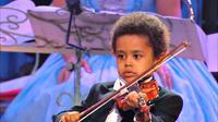 Seorang anak lelaki yang waktu itu berusia 5 tahun memiliki bakat musik yang luar biasa.