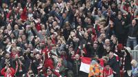 Striker Liverpool Sadio Mane berselebrasi usai mencetak gol ke gawang Leicester City dalam lanjutan Liga Inggris di Stadion Anfield, Sabtu (5/10/2019).  (AP Photo/Jon Super)