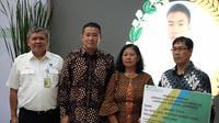 BPJS Ketenagakerjaan serahkan santunan kecelakaan kerja kepada ahli waris pegawai Air Nav. (foto: BPJS Ketenagakerjaan)