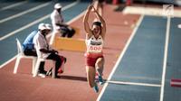 Ekspresi Atlet Lompat Jauh Indonesia, Maria Natalia Londa saat berlaga di nomor triple jump putri SEA Games di Stadium Bukit Jalil, Malaysia, Rabu (23/8). (Liputan6.com/Faizal Fanani)