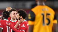 Liverpool memetik kemenangan 1-0 atas Wolverhampton Wanderers pada laga pekan ke-28 Premier League di Molineux Stadium, Selasa (16/3/2021) dini hari WIB. (AFP/POOL/Paul Ellis)