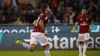 Suso (berlari) menyumbang satu gol untuk membantu AC Milan menang 2-1 atas Bologna pada pekan ke-35 Liga Italia 2018/19 di San Siro, Selasa (7/5/2019) dini hari WIB.(AP Photo/Antonio Calanni)