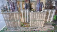 Maket proyek pembangunan rumah susun dengan konsep TOD, Pondok Cina, Depok, Jawa Barat, Senin (2/10). Proyek ini dalam rangka percepatan pembangunan program satu juta rumah dan mengurangi angka backlog perumahan. (Liputan6.com/Immanuel Antonius)