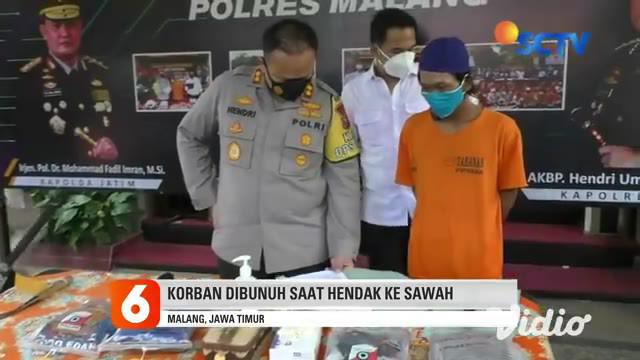Sigit warga Karangsuko, Kecamatan Pagelaran, Malang, Jawa Timur, tak berkutik saat ditangkap dan dibawa ke Mapolres Malang pada Kamis siang (19/11). Pelaku ditangkap setelah melakukan pembunuhan berencana terhadap tetangganya.