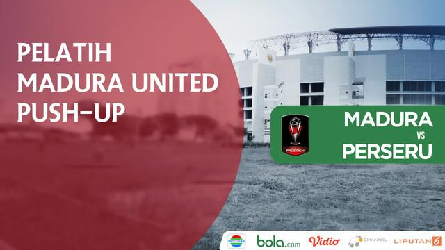 Pelatih Madura United, Gomes De Oliveira push up setelah Greg Nwokolo mencetak gol.