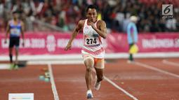 Atlet para atletik Indonesia, Rasyidi bersiap melakukan lompatan pada lomba lompat jauh T44, T62/T64 putra Asian Para Games 2018 di Stadion Utama Gelora Bung Karno, Jakarta, Jumat (12/10). Rasyidi meraih perunggu. (Liputan6.com/Helmi Fithriansyah)
