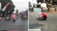 Seseorang berkendara motor sambil berdiri di Juwana, Pati, Jawa Tengah. (Sumber: Twitter @kebahagyaan)