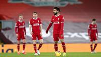 Performa Mohamed Salah dan Liverpool tengah menurun drastis di kompetisi Liga Inggris. Peluang Liverpool mempertahankan gelar makin tipis usai kalah 1-4 dari Manchester City. (Laurence Griffiths/Pool via AP)