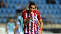 Pemain Atletico Madrid, Jose Maria Gimenez mencetak satu gol saat Atletico Madrid menang telak atas SD Eibar pada lanjutan La Liga Spanyol pekan ke-23. (AFP/Cristina Quicler)