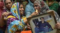 Keluarga Zulfiqar Ali di Lahore, Pakistan, bergembira menyambut pembatalan eksekusi mati, Jumat (29/7/2016). (BBC)