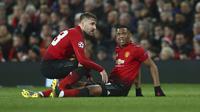Striker Manchester United, Anthony Martial, mengalami cedera saat takluk 0-2 dari Paris Saint-Germain pada leg pertama 16 besar Liga Champions di Old Trafford, Selasa (12/2/2019) waktu setempat. (AP Photo/Dave Thompson)