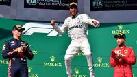 Pembalap Mercedes-AMG Petronas Motorsport, Lewis Hamilton, meraih podium juara di F1 GP Hungaria, Sirkuit Hungaroring, Minggu (4/8/2019) malam WIB. (AFP/Andrej Isakovic)