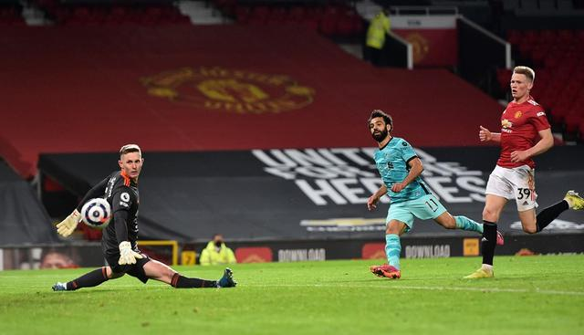 Liverpool meraih kemenangan 4-2 atas Manchester United pada laga tunda pekan ke-34 Premier League di Old Trafford, Jumat (14/5/2021) dini hari WIB. (PETER POWELL/POOL/AFP)