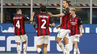Striker AC Milan, Zlatan Ibrahimovic mencetak dua gol ke gawang Inter Milan dalam lanjutan Liga Italia Serie A, Sabtu (17/10/2020). (AP Photo/Antonio Calanni)