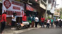 Posko makan gratis di Taman Bayu, RT 003 RW 018, Kec Duren Sawit, Klender Jakarta Timur,