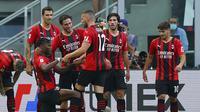 Para pemain AC Milan merayakan gol ke gawang Lazio dalam lanjutan Liga Italia 2021/2022, Minggu (12/9/2021). (Spada/LaPresse via AP)