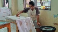 """Aditya Dwi Saputra, Penyandang Disabilitas Intelektual di BBRSPDI """"Kartini"""" Temanggung."""
