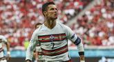 Penyerang Portugal, Cristiano Ronaldo melakukan selebrasi usai mencetak gol ke gawang Hungaria pada pertandingan grup F Euro 2020 di stadion Ferenc Puskas di Budapest, Hungaria, Selasa (15/6/2021). Ronaldo mencetak dua gol dipertandingan ini dan mengantar Portugal menang atas Hungaria 3-0. (Bernadet