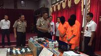 Polda Papua libatkan Interpol untuk mengungkap mafia judi togel di Timika. (Liputan6.com/Katharina Janur)