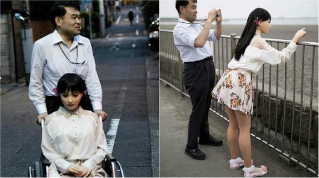 Masayuki Ozaki berjalan-jalan romantis dengan boneka seks miliknya. (Sumber AFP/Behrouz Mehri)