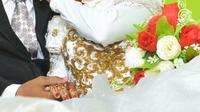 Ilustrasi – Pasangan pengantin . (Foto: Liputan6.com/Muhamad Ridlo)