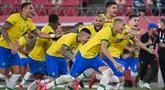 Timnas U-23 Brasil pastikan tiket final setelah kalahkan Meksiko di babak adu pinalti. Pertandingan semifinal tersebut merupakan duel para juara Olimpiade, dimana Brasil adalah juara bertahan Olimpiade Rio 2016 dan Meksiko merupakan juara Olimpiade London 2012. (Foto: AFP/Martin Bernetti)