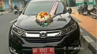 Mobil dinas pejabat di Klaten dihias untuk mobil pengantin.(Istimewa/Solopos.com)