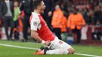 Mesut Ozil merayakan gol yang dicetaknya di menit akhir ke gawang Bayern Munchen dalam laga Grup F Liga Champions di Stadion Emirates, London, Rabu (21/10/2015) dini hari WIB. (EPA/Andy Rain)