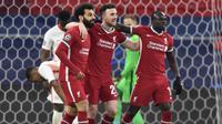Liverpool meraih kemenangan 2-0 atas RB Leipzig pada laga leg kedua 16 besar Liga Champions di Puskas Arena, Budapest, Kamis (11/3/2021) dini hari WIB. Hasil itu membuat The Reds berhak lolos ke perempat final dengan agregat 4-0. (AFP/Attila Kisbenedek)