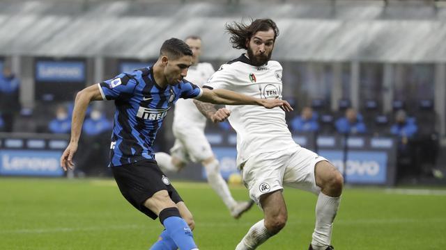 Bek Inter Milan, Achraf Hakimi mencetak gol ke gawang Spezia di Giuseppe Meazza, Minggu (20/12/2020).