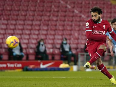 Mohamed Salah menjadi pencetak gol terbanyak Liverpool di ajang Liga Champions. Winger asal Mesir tersebut, tercatat telah menorehkan gol sebanyak 32 kali. Musim ini, Salah juga mampu menjadi top skor sementara Liga Inggris dengan raihan tujuh gol. (AFP/Pool/Tim Keeton)