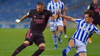 Karim Benzema gagal membawa Real Madrid mengalahkan Real Sociedad pada laga perdana tim di Liga Spanyol 2020/2021. (ANDER GILLENEA / AFP)