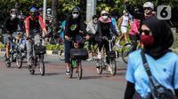 Warga bersepeda di kawasan Thamrin, Jakarta Pusat, Minggu (15/11/2020). Di masa PSBB transisi Jakarta, warga tetap melakukan aktivitas olahraga, khususnya bersepeda yang kini banyak diminati bahkan menjadi tren. . (Liputan6.com/Johan Tallo)
