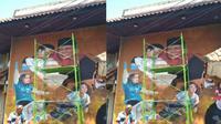 Momen Jokowi dan Prabowo dipeluk atlet pencak silat Asian Games 2018 diabadikan di tembok RM Kusuma Sari Jalan Slamet Riyadi Solo. (Solopos/Indah Septiyaning W.)