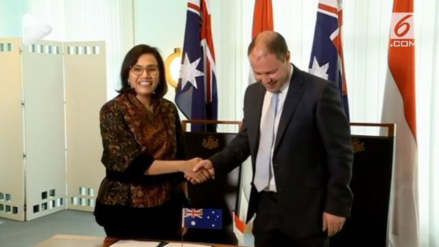 Menteri Keuangan Indoneisa Sri Mulyani dan Menteri Keuangan Australia Joshua Frydenberg menandatangani MoU pembaruan kerangka kerja untuk pertukaran kebijakan dan teknis antar dua pemerintah di Gedung Parlemen Australia, Canberra (5/11)
