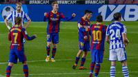 Barcelona meraih kemenangan 2-1 atas Real Sociedad pada laga lanjutan La Liga di Camp Nou, Kamis (17/12/2020) dini hari WIB. (AP Photo/Joan Monfort)