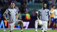 Dua pemain Real Madrid, Gareth Bale (kiri) dan Karim Benzema (kanan). (AFP/Javier Soriano)