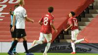 Jesse Lingard merayakan gol ke gawang LASK pada leg kedua 16 besar Liga Europa 2019/2020 di Old Trafford, Kamis (6/8/2020) dini hari. (AFP/Oli Scarff)