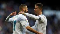 Karim Benzema dan Cristiano Ronaldo (AP Photo/Francisco Seco)