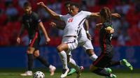Aksi Jude Bellingham bersama timnas Inggris saat melawan Ukraina di Euro 2020 / 2021 (AFP)