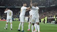 Winger Real Madrid, Vinicius Junior, merayakan gol ke gawang Barcelona pada laga pekan ke-26 La Liga Spanyol di Santiago Bernabeu, Minggu (1/3/2020). Madrid pun menang 2-0 atas Barca. (AFP/OSCAR DEL POZO)
