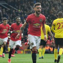 Gelandang Manchester United, Bruno Fernandes, berkontribusi membantu timnya menang 3-0 atas Watford pada laga pekan ke-27 Premier League di Old Trafford, Minggu (23/2/2020). (AFP/Paul Ellis)