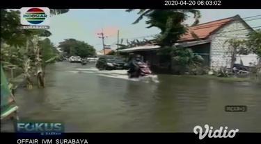 Musim penghujan yang belum usai menambah ancaman baru di tengah pandemi corona. Seperti banjir di Lamongan belasan desa masih di kepung banjir.