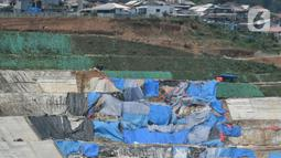 Barat, Jumat (3/9/2021). Proyek 13 bendungan tersebut bagian dari target pembangunan 61 bendungan selama periode 2020-2024. (Liputan6.com/Herman Zakharia)