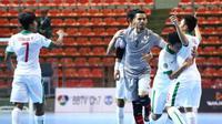 Timnas Futsal Indonesia U-20 merayakan keberhasilan lolos ke babak perempat final Piala Asia U-20. (AFC)
