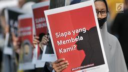 Aktivis menggelar aksi penolakan Rancangan Undang-undang Penghapusan Kekerasan Seksual (RUU PKS) di area car free day, Bundaran HI, Jakarta, Minggu (28/4/2019). Aksi itu menolak disahkannya RUU PKS yang tengah dibahas oleh DPR karena dinilai tidak berazaskan agama. (merdeka.com/Iqbal S. Nugroho)