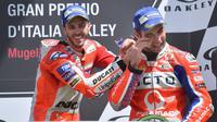 Pebalap Pramac Ducati, Danilo Petrucci, siap bersaing dengan Andrea Dovizioso untuk menjadi yang terbaik di belakang kemudi motor Ducati pada MotoGP Belanda, Minggu (25/6/2017) (EPA/Luca Zennaro)