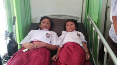 Sebanyak 15 anak di SD Negeri 3 Sidanegara, Cilacap diduga keracunan usai mengonsumsi susu kemasan. (Foto: Liputan6.com/Istimewa/Muhamad Ridlo)