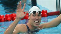 Dalam foto file ini diambil pada 12 Agustus 2008, perenang AS Klete Keller tersenyum setelah memenangi cabang renang estafet gaya bebas 4 x 200m putra di National Aquatics Center pada Olimpiade Beijing 2008. (Greg WOOD / AFP)