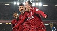 Gelandang Liverpool, Xherdan Shaqiri, merayakan gol yang dicetaknya ke gawang Mnachester United pada laga Premier League di Stadion Anfield, Liverpool, Minggu (16/12). Liverpool menang 3-1 atas MU. (AFP/Paul Ellis)